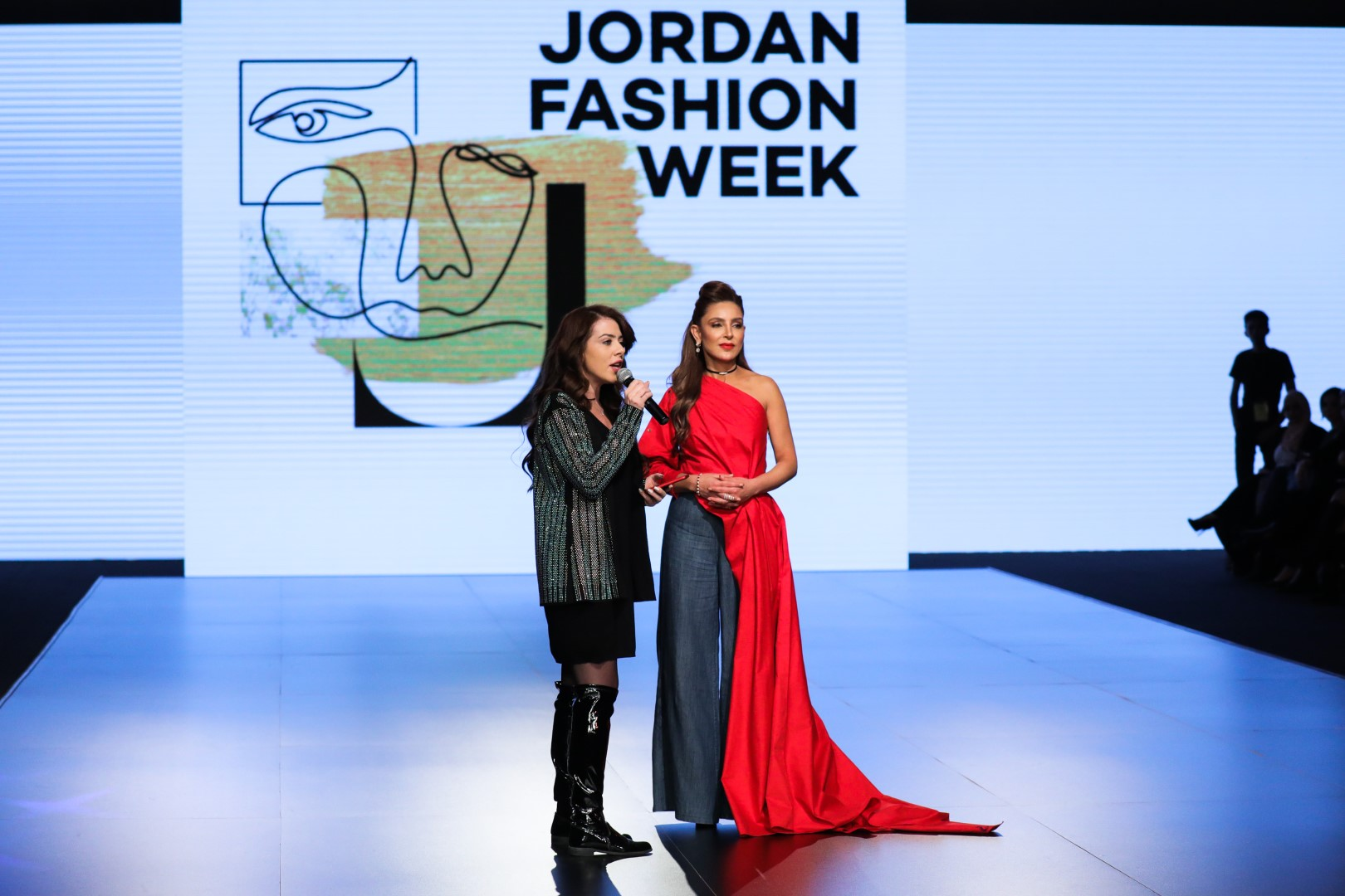 AMMAN, JORDAN - MARCH 30: (L-R)  Zena Zananiri from Ayla Oasis Management Company and founder of Jordan Fashion Week Shirene Rifai speak on the runway prior to the Lindt Chocolate Couture show during Jordan Fashion Week 019 at the Kempinski Amman on March 30, 2019 in Amman, Jordan.  (Photo by Thomas Concordia/Getty Images for Jordan Fashion Week)